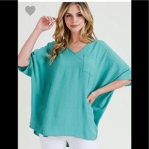 Sea foam green v-neck pocket top